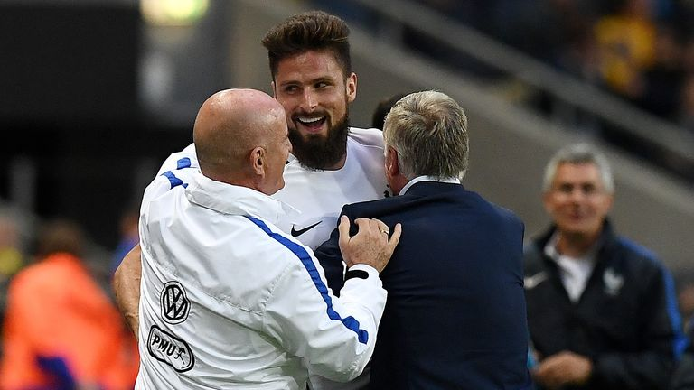 Oliver Giroud celebrates with France boss Didier Deschamps after his goal against Sweden