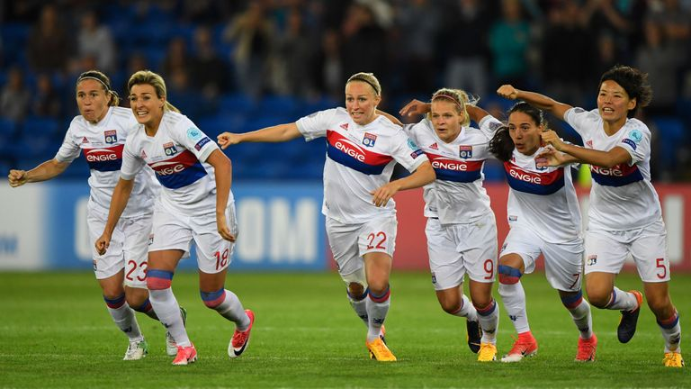 Lyon players celebrate the shootout victory