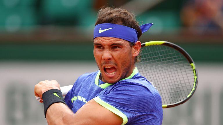 Defending champion Novak Djokovic rallies for win at French Open
