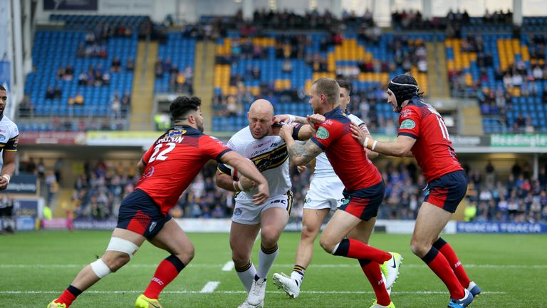 Leeds Rhinos' Carl Ablett powers through the Featherstone defence during the Ladbrokes Challenge Cup quarter-final