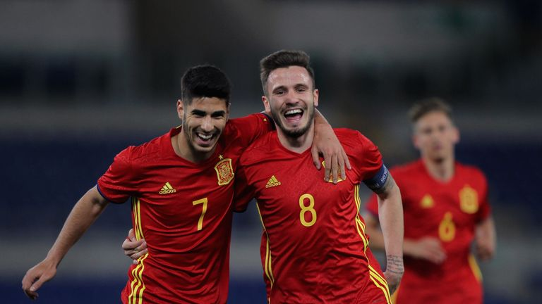 Real's Marco Asensio (L) and Atletico's Saul Niguez (R) play for Spain's U21s
