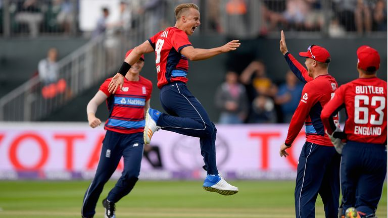 Curran celebrates after taking his first international wicket for England