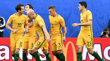 Australia's midfielder Mark Milligan (2nd L) is congratulated after scoring