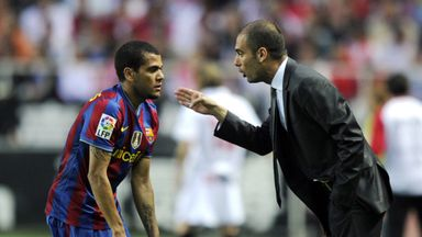 Pep Guardiola (R) speaks with Dani Alves (L) during their time at Barcelona