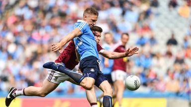 Eoghan O'Gara scoring his sides second goal despite the efforts of Callum McCormack of Westmeath