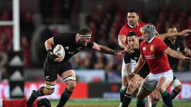 All Blacks captain Kieran Read holds off Jonathan Davies of the Lions