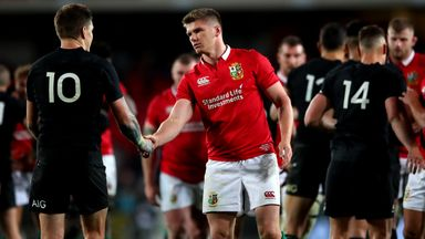 Owen Farrell shakes hands with Beauden Barrett after the Lions' loss