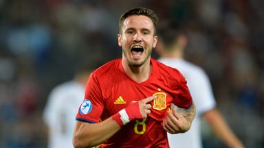 Saul Niguez scored a fine hat-trick to send Spain through