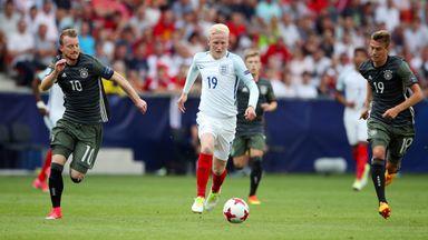 England's Will Hughes runs through Germany's Maximilian Arnold (left) and Janik Haberer
