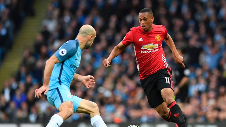 Anthony Martial looks for a way past Pablo Zabaleta during the Manchester derby at the Etihad Stadium