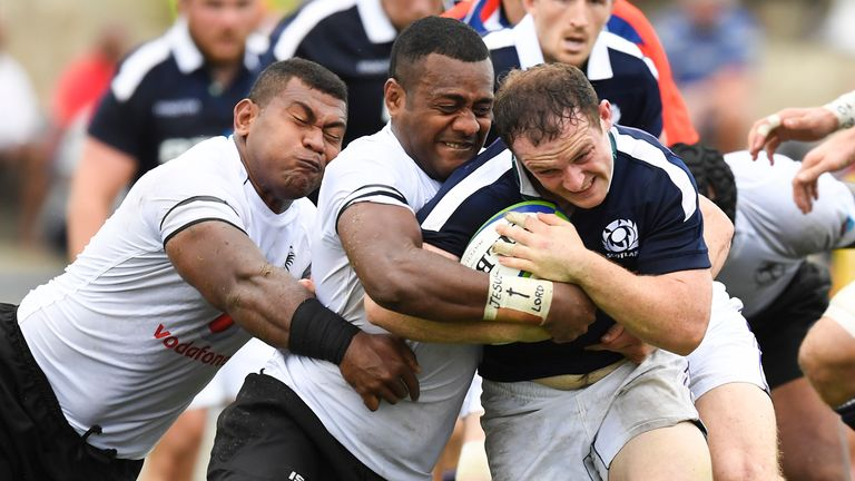 Nick Grigg is tackled by Fiji's Kini Murimurivalu