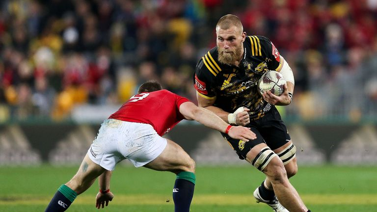 Brad Shields of the Hurricanes is tackled by Greig Laidlaw during the British & Irish Lions tour match at Westpac Stadium