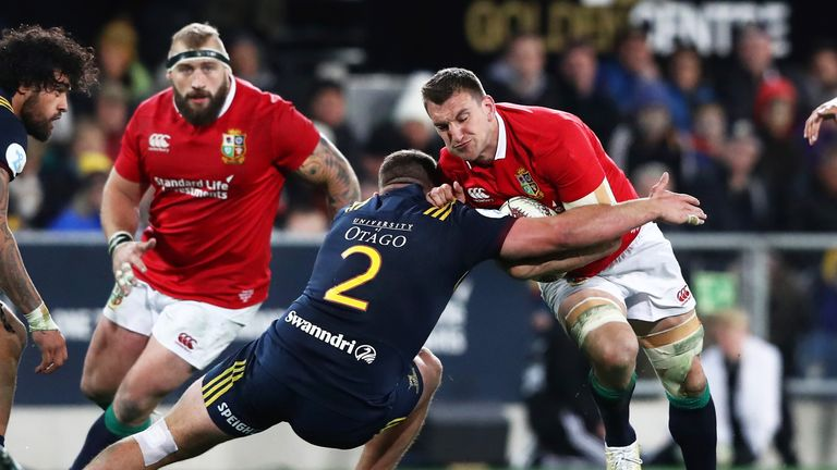Sam Warburton of the Lions is tackled by Liam Coltman of the Highlanders during the 2017 British & Irish Lions tour match