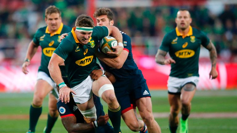 South Africa's flanker Jaco Kriel (centre) is tackled during the Test match against France