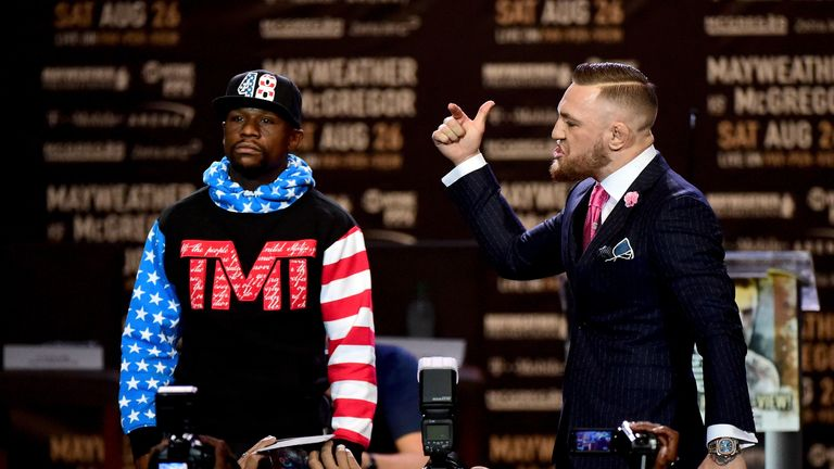 Conor McGregor taunts Floyd Mayweather on stage