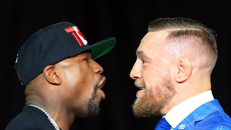 Mayweather and Conor McGregor face-off during their press conference in Toronto