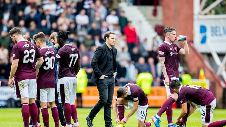 Hearts coach Ian Cathro (centre) saw his side's League Cup hopes dashed