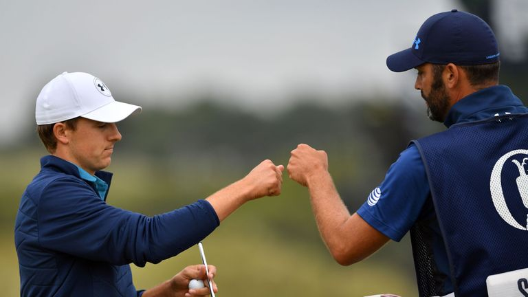 Spieth and caddie Michael Greller celebrate a big birdie on the 16th