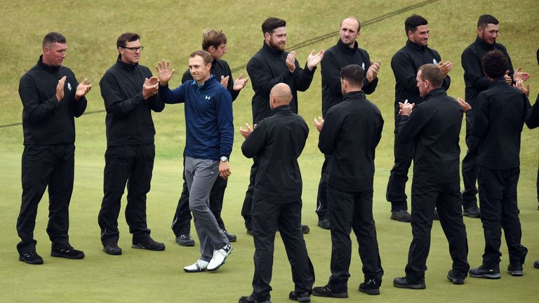 Spieth gets a guard of honour as he goes to collect his prize