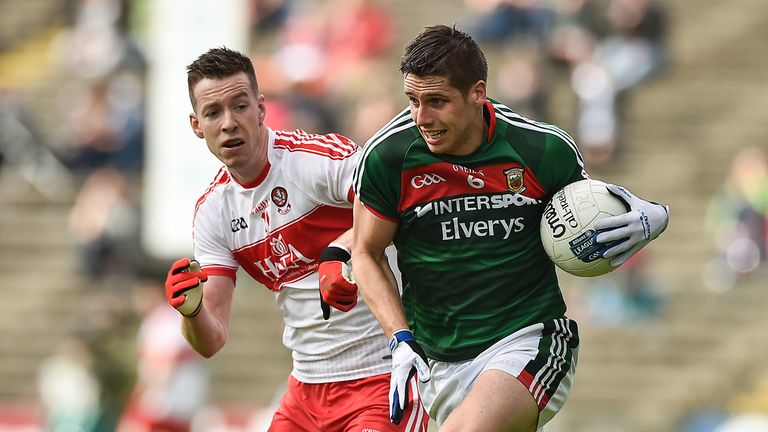Lee Keegan of Mayo in action against Niall Loughlin