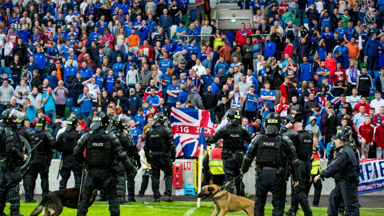 Police take up position at full time in front of the Linfield supporters in Belfast