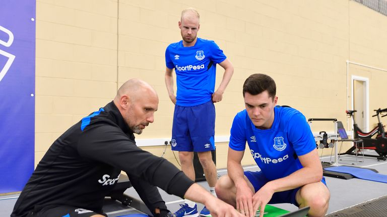 Michael Keane examines his data at Everton testing