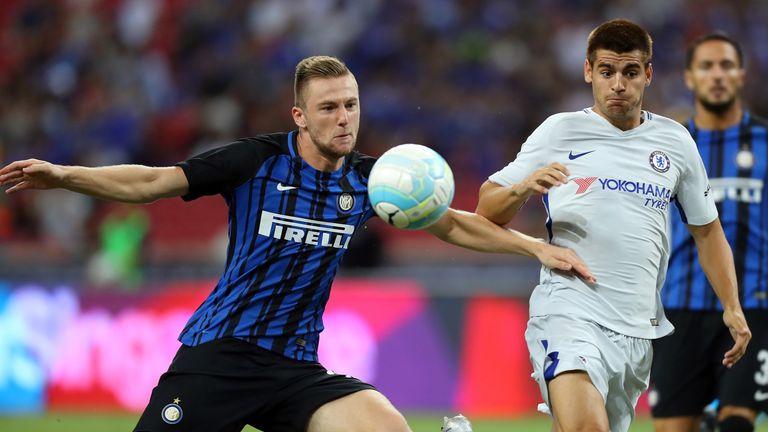 Milan Skriniar ushers the ball away from Alvaro Morata