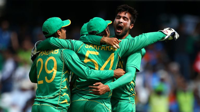 Mohammad Amir and his team-mates celebrate a wicket at The Oval