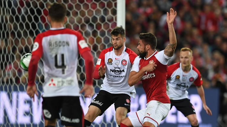 Olivier Giroud smartly turns the ball high into the net against Western Sydney Wanderers