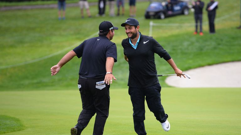 Patrick Reed (left) and Alexander Levy were having fun during their rain-delayed second round