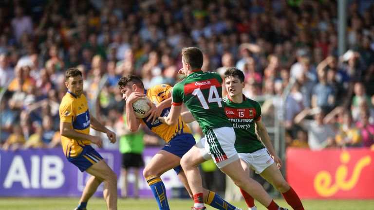 Pearse Lillis of Clare in action against Cillian O'Connor, left, and Conor Loftus of Mayo