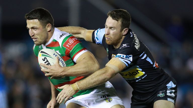 Sam Burgess is tackled by James Maloney as the Rabbitoh faced the Sharks