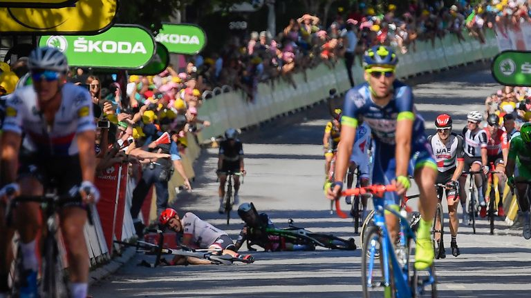 Cavendish and John Degenkolb lie on the ground after falling near the finish line