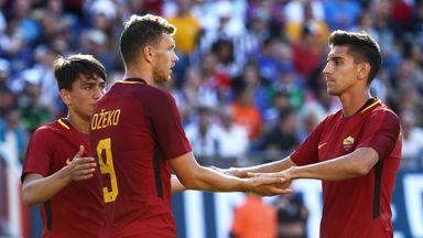 Edin Dzeko celebrates after opening the scoring for Roma