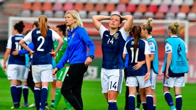 Scotland forward Jane Ross (C) reacts after their defeat to Portugal