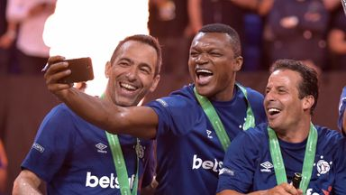 Marcel Desailly takes a photograph with Youri Djorkaeff (L) and and Ludovic Giuly (R)
