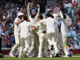 Moeen Ali of England celebrates with team mates after completing his hat trick