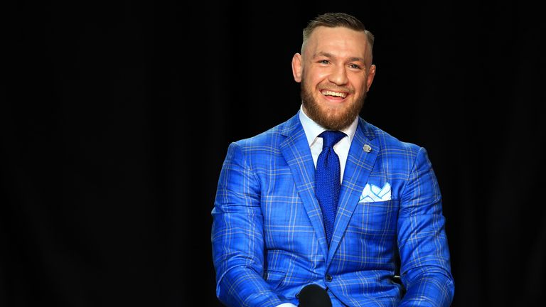 Conor McGregor smiles during the Mayweather v McGregor World Press Tour in Toronto