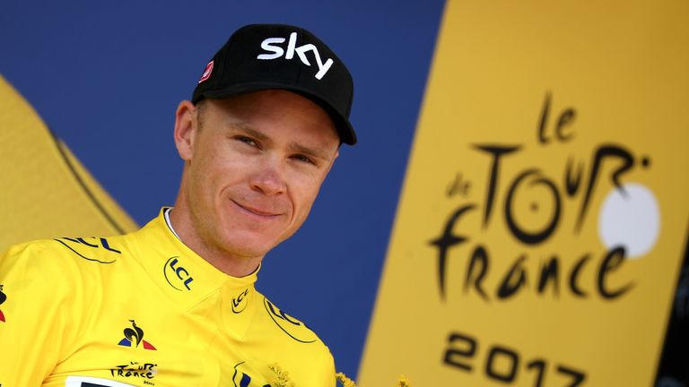 EMBRUN, FRANCE - JULY 21:  Christopher Froome of Great Britain riding for Team Sky in the leader's jersey poses for a photo on the podium following stage 1