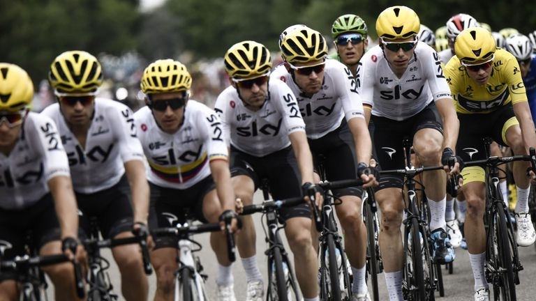 Chris Froome (in yellow) was protected well by his Team Sky team-mates on stage 11