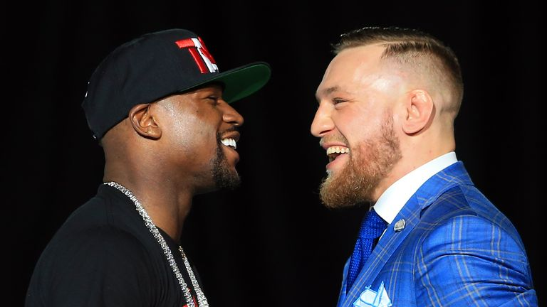 Floyd Mayweather Jr. and Conor McGregor faceoff during their World Press Tour in Toronto