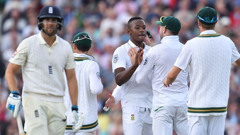South Africa's Kagiso Rabada (C) celebrates with theammates, bowling out England's Dawid Malan (L) for one on the first day of the third Test