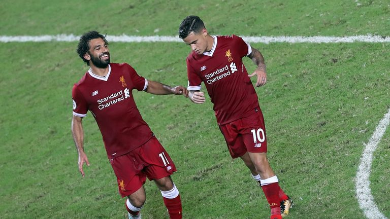 Philippe Coutinho of Liverpool reels away after scoring while Mohamed Salah runs to embrace him during the Premier League Asia Trophy final v Leicester