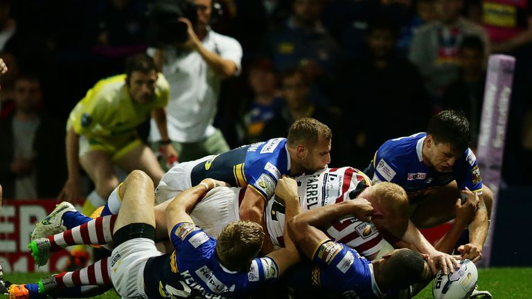 LEEDS, ENGLAND - AUGUST 14: Liam Farrell of Wigan Warriors touches the ball over the line during the Round 2 match of the First Utility Super League Super