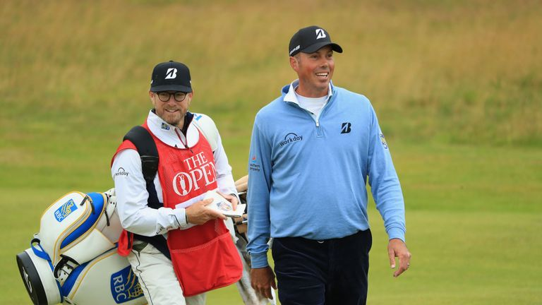 Matt Kuchar of the United States walks down the 1st fairway with his caddie during the second round of the 146th Open Championship