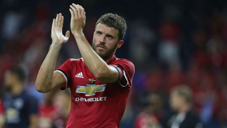 Michael Carrick says Man Utd must target the title