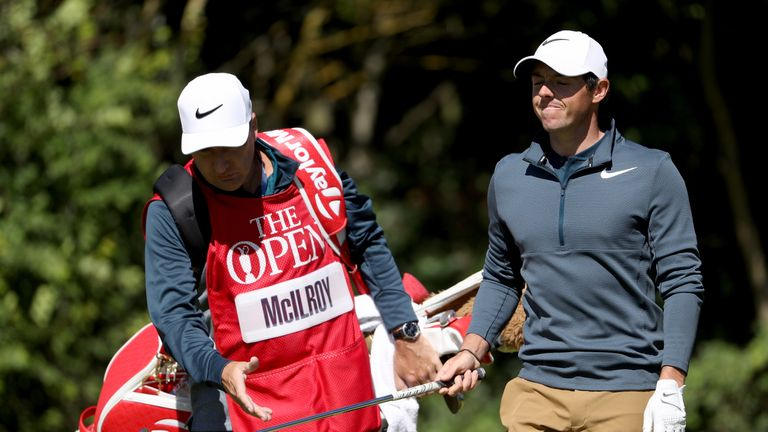 Rory McIlroy of Northern Ireland looks dejected as he hands the club to his caddie JP Fitzgerald at The Open