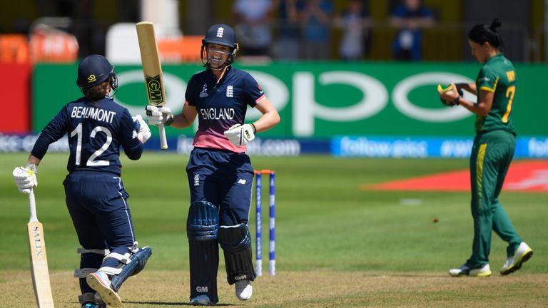 Sarah Taylor celebrates  reaching three figures with fellow centurion Tammy Beaumont against South Africa during the ICC Women's World Cup