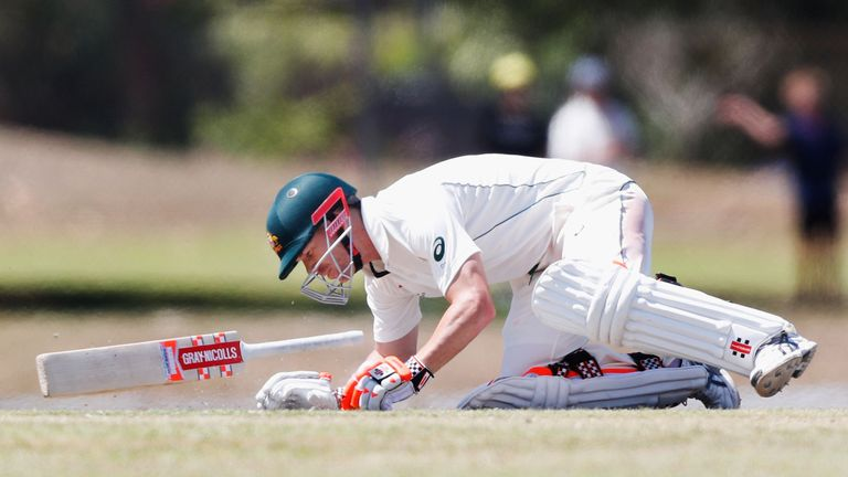 David Warner falls to the floor after being struck by Josh Hazelwood in Darwin