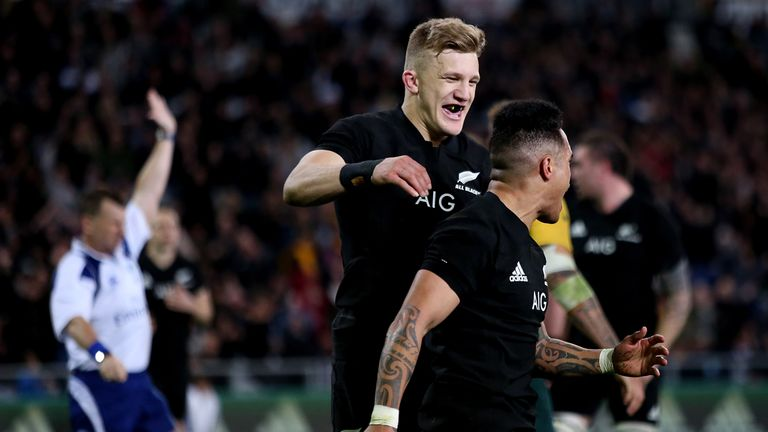 Damian McKenzie celebrates with Aaron Smith after the scrum-half's score